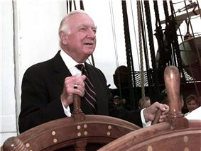 Walter Cronkite steering a ship