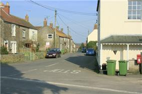 Street scene. Houses to left and right of road junction.