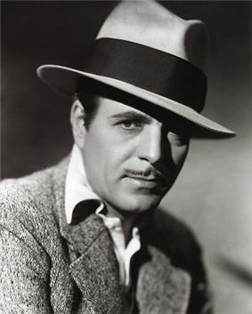 Warner Baxter in black and white promo photo