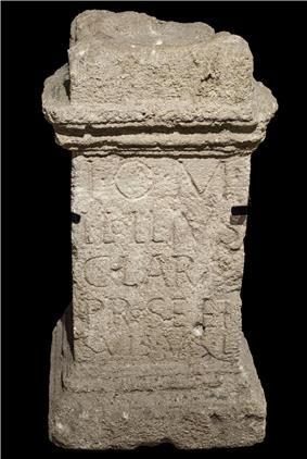 Narrow stone altar, with inscription