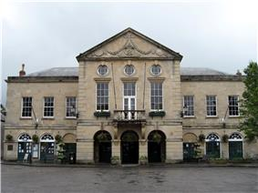 Symmetrical two storey building in classical style with nine bays.