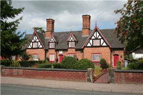 Tollemache Almshouses, 118–128 Welsh Row