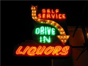 A green and orange neon sign that says