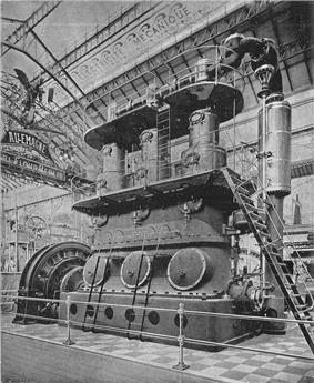 A large three-cylinder stationary steam engine, driving a dynamo generator. The engine is so tall that there are two gallery walkways around it at different heights, with ladders between them.