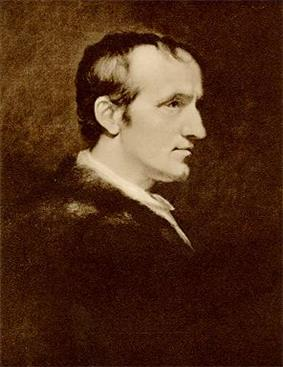 Half-length profile portrait of a man. His dark clothing blends into the background and his white face is in stark contrast.