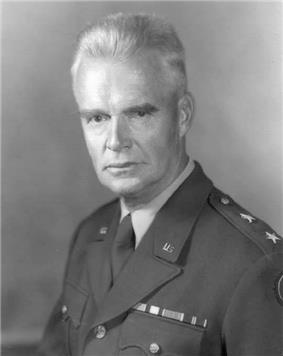 A Caucasian man in his late 50s with gray hair in a military uniform