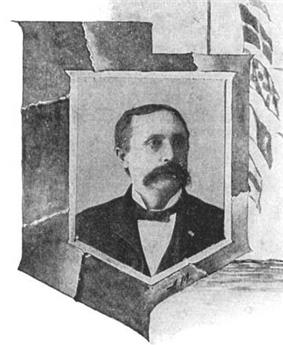 Head and shoulders of an otherwise-cleancut man with an enormous mustache, in circa-1900 formal dress.