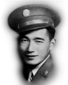 Head of a smiling young man wearing a peaked cap with a round medallion on the front and a military jacket over a shirt and tie.