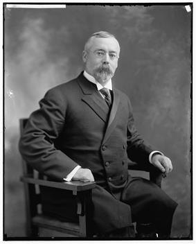 Upper-body portrait of an early-twentieth-century man in a suit.