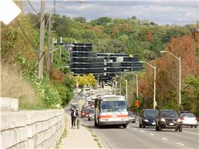 A eastward view along Wilson Avenue toward Yonge Street as it passes through Hoggs Hollow.