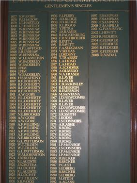 A black board featuring the year of every Wimbledon championship next to the name of its winner