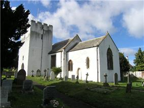 White painted church with square tower.