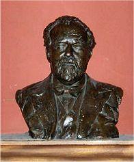 metal bust of an elderly man with moustache, beard and receding hair