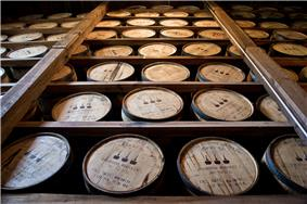 Barrels of Woodford Reserve bourbon aging in a rickhouse.