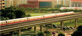 The Mass Rapid Transit line at Woodlands, with the Woodlands Civic Centre in the background.