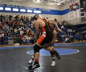 Two competitors in an Amateur Wrestling match