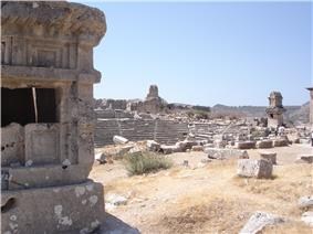 Ruins of buildings and of an amphitheatre.