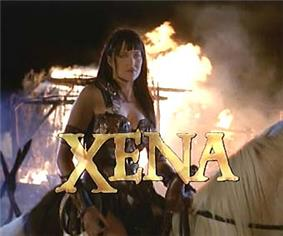 A woman in leather armor sits on horseback with flames behind her. At the bottom of the screen in capital letters is the word