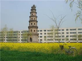 Pagoda in Xinzheng with Soviet architecture in the background