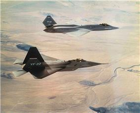 Two different jet aircraft in flight towards right of screen.