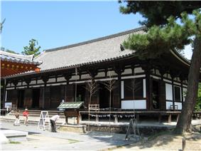 Wooden building with white walls and a slightly raised floor.