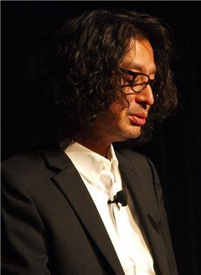 Portrait of Yoshio Sakamoto, making a public speech.
