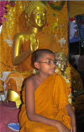 Young Indian Buddhist monk in Indian monastery.png